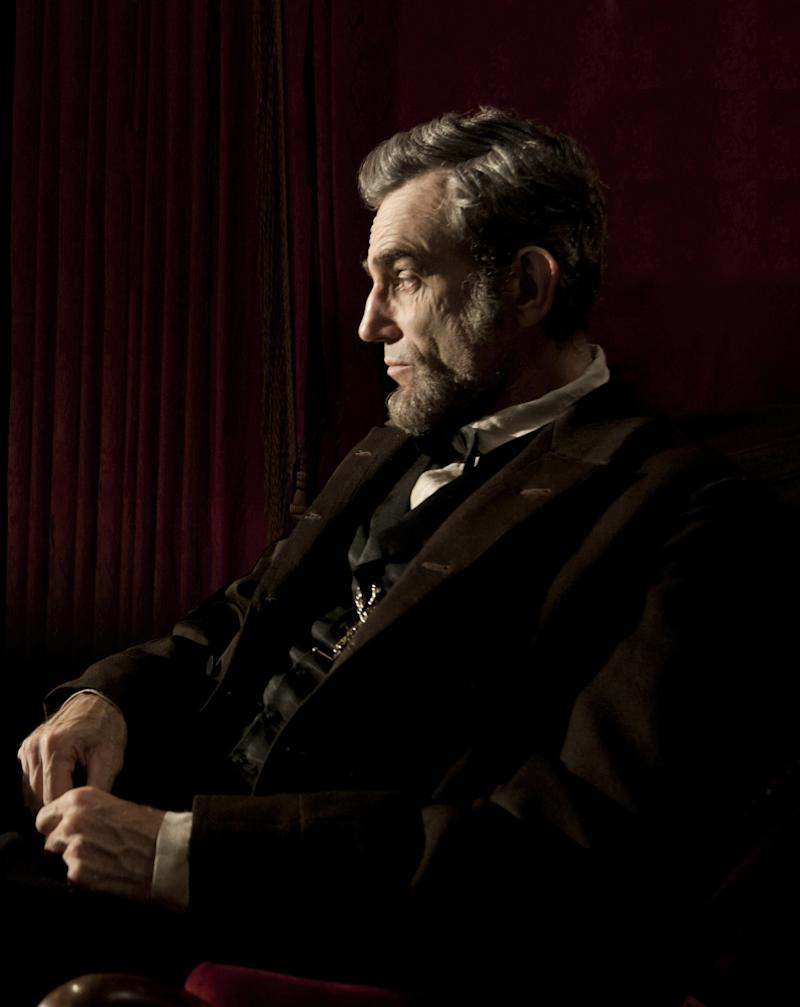 """This publicity film image released by Walt Disney Pictures shows Daniel Day-Lewis portraying Abraham Lincoln in the film """"Lincoln.""""  The film, directed by Steven Spielberg, opens in limited release Nov. 9 and nationwide Nov. 16, just after the U.S. presidential election. (AP Photo/Disney-DreamWorks II, David James)"""