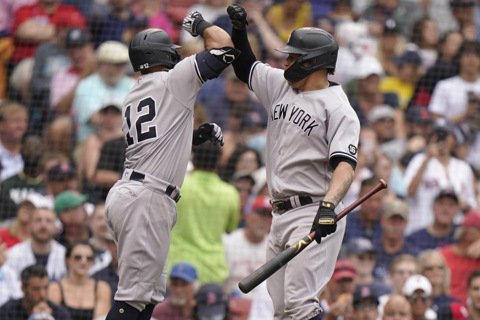 New York Yankees' Rougned Odor, left, celebrates his home run with Gary Sanchez, right, as he arrives a home plate in the sixth inning of a baseball game against the Boston Red Sox, Sunday, July 25, 2021, in Boston. (AP Photo/Steven Senne)