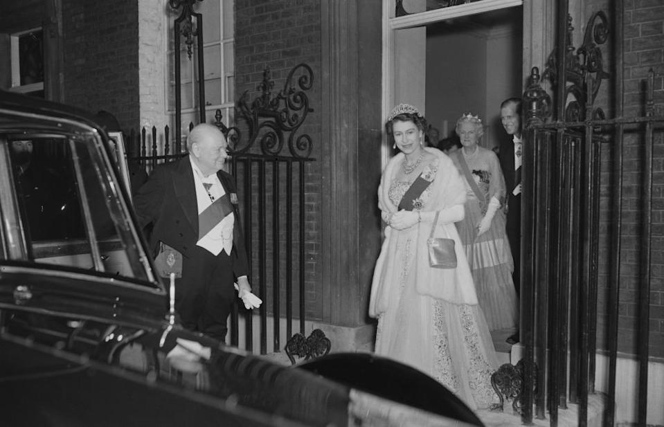 Queen Elizabeth II and Prince Philip leave 10 Downing Street in London after having dinner with Sir Winston Churchill (1874 - 1965), the British Prime Minister and his wife.   (Photo by Fox Photos/Getty Images)