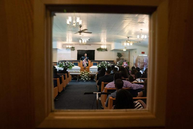 Pastor James Parker speaks at a double funeral service for Lola M. Simmons-Jones and her daughter Lashaye Antoinette Allen, at the Denley Drive Missionary Baptist Church in Dallas on July 30, 2020, who both died of coronavirus.