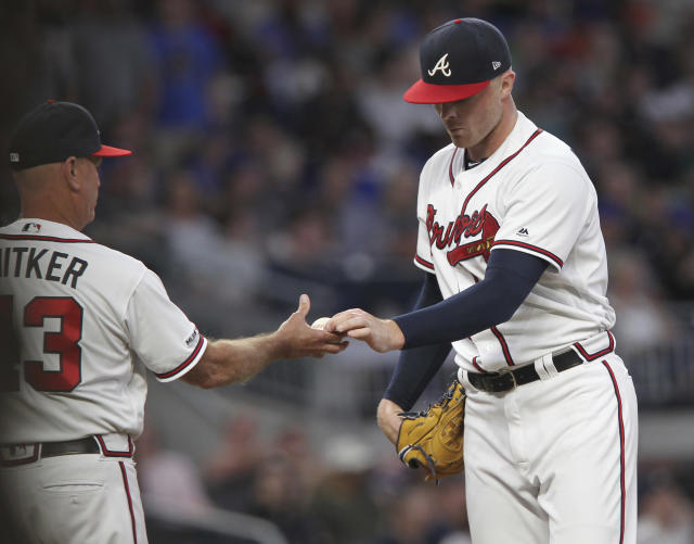 Atlanta Braves' Sean Newcomb is pulled by manager Brian Snitker during the second inning against the New York Mets in a baseball game Saturday, April 13, 2019, in Atlanta. (AP Photo/Tami Chappell)
