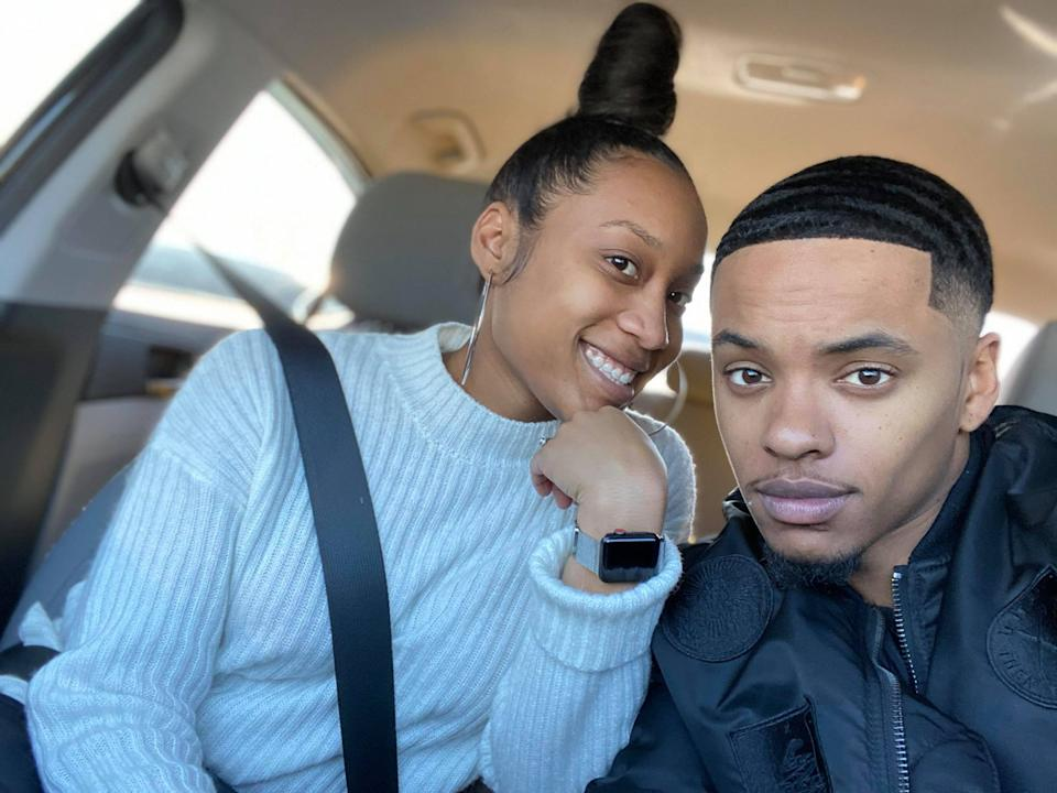 Bria Williams, 26, and her husband Adrian, 25, sitting in a car