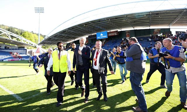 "Soccer Football - Premier League - Huddersfield Town vs Arsenal - John Smith's Stadium, Huddersfield, Britain - May 13, 2018 Arsenal manager Arsene Wenger on the pitch after the match Action Images via Reuters/Andrew Boyers EDITORIAL USE ONLY. No use with unauthorized audio, video, data, fixture lists, club/league logos or ""live"" services. Online in-match use limited to 75 images, no video emulation. No use in betting, games or single club/league/player publications. Please contact your account representative for further details."