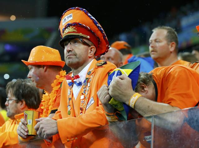 Netherlands' fans show dejection after the 2014 World Cup semi-finals against Argentina at the Corinthians arena in Sao Paulo July 9, 2014. REUTERS/Darren Staples (BRAZIL - Tags: SOCCER SPORT WORLD CUP TPX IMAGES OF THE DAY)