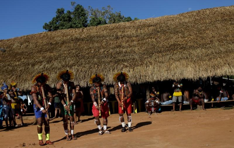 IIndigenous people of Enawene-nawe tribe, perform a greeting dance during a four-day pow wow in Piaracu village, in Xingu Indigenous Park, near Sao Jose do Xingu, Mato Grosso state