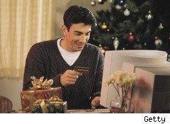 man shops online at holiday - holiday shopping sites to save you...