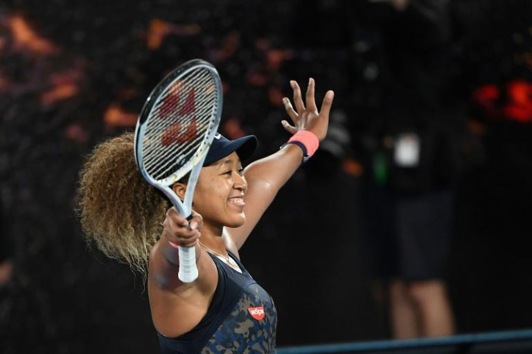 Naomi Osaka celebrates championship point to win her fourth Grand Slam title at the Australian Open on Saturday