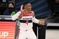 Washington Wizards guard Russell Westbrook (4) reacts after a shot during the first half of an NBA basketball game against the Chicago Bulls, Tuesday, Dec. 29, 2020, in Washington. (AP Photo/Nick Wass)