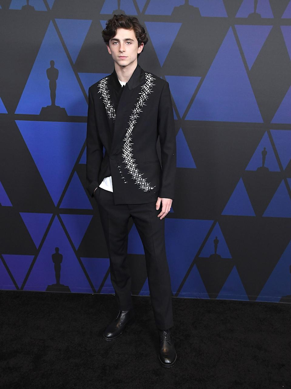 Wearing an embroidered jacket by Haider Ackermann. <em>[Photo: Getty]</em>