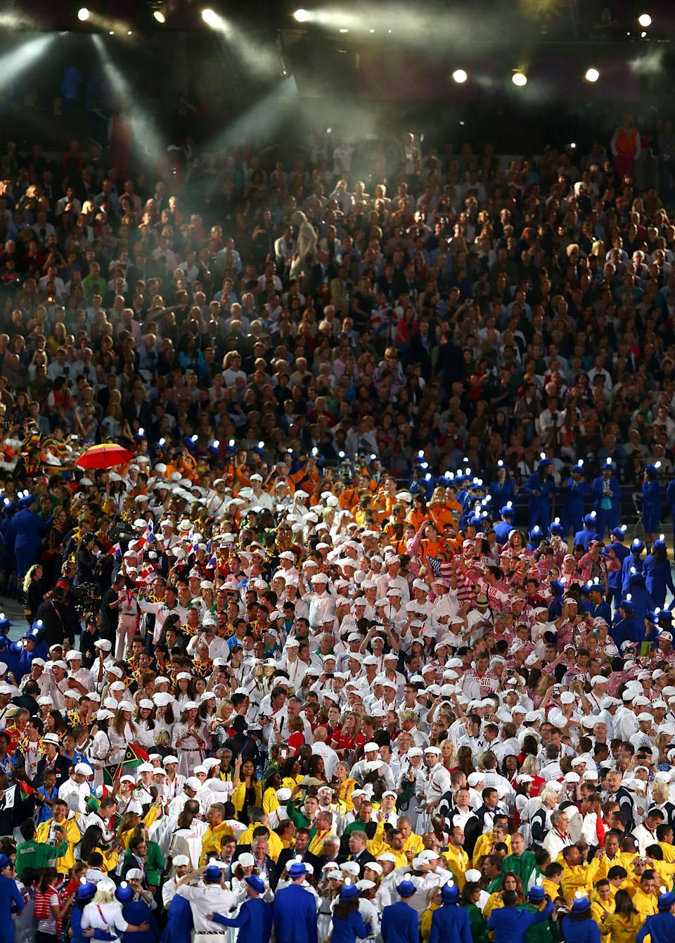 Athletes enter the stadium during the Closing Ceremony on Day 16 of the London 2012 Olympic Games at Olympic Stadium on August 12, 2012 in London, England. (Photo by Michael Steele/Getty Images)