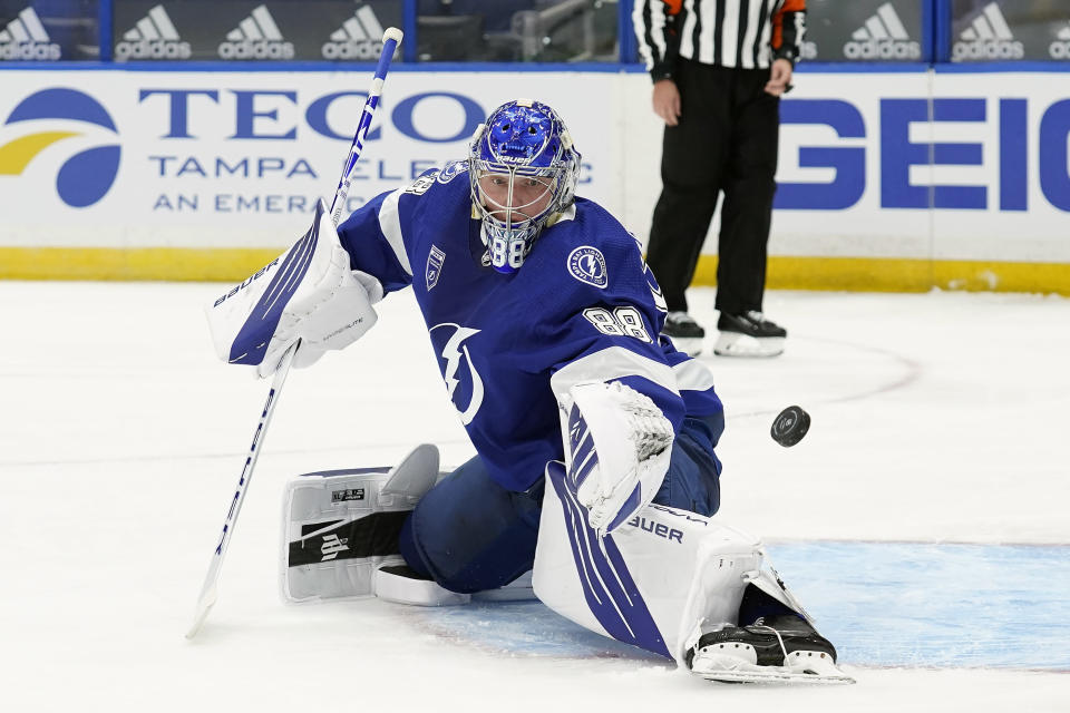 Tampa Bay Lightning goaltender Andrei Vasilevskiy (88) makes a save on a shot by the Chicago Blackhawks during the third period of an NHL hockey game Wednesday, Jan. 13, 2021, in Tampa, Fla. (AP Photo/Chris O'Meara)
