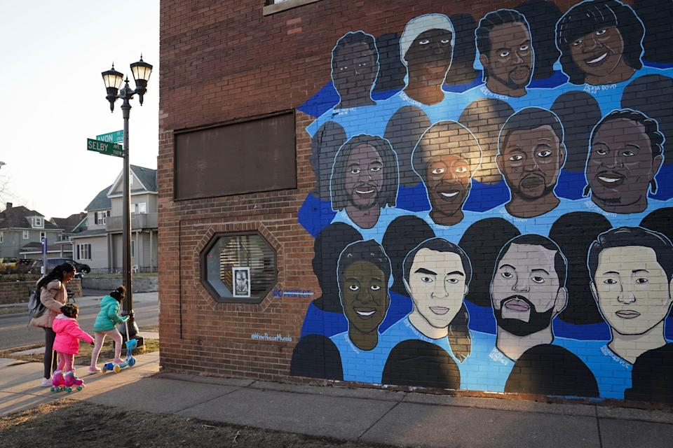 A mural in Minneapolis shows the faces of people who have died at the hands of police.