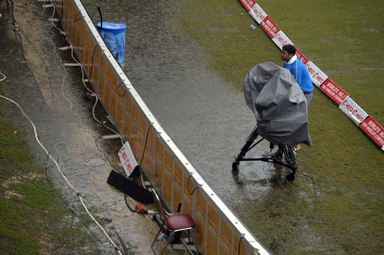 A TV cameraman packs up after the fifth match of the Tri-Nation series between Sri Lanka and West Indies was called off due to rain at the Queen's Park Oval stadium in Port of Spain on July 7, 2013. Persistent rain caused the match to be called off for the day after only 19 overs were bowled during Sri Lanka's innings with a score of 60/3. The match will continue from the current state on July 8. AFP PHOTO/Jewel Samad        (Photo credit should read JEWEL SAMAD/AFP/Getty Images)