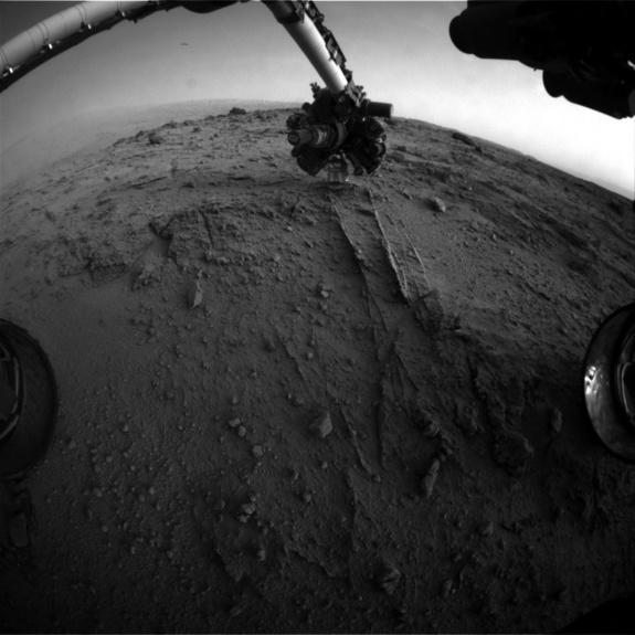 This image shows the view from NASA's Mars rover Curiosity after it uses an autonomous proximity placement technique to place its tool-laden robotic arm on a rock science target called 'Darwin' during the 399th Martian day, or sol, of its missi