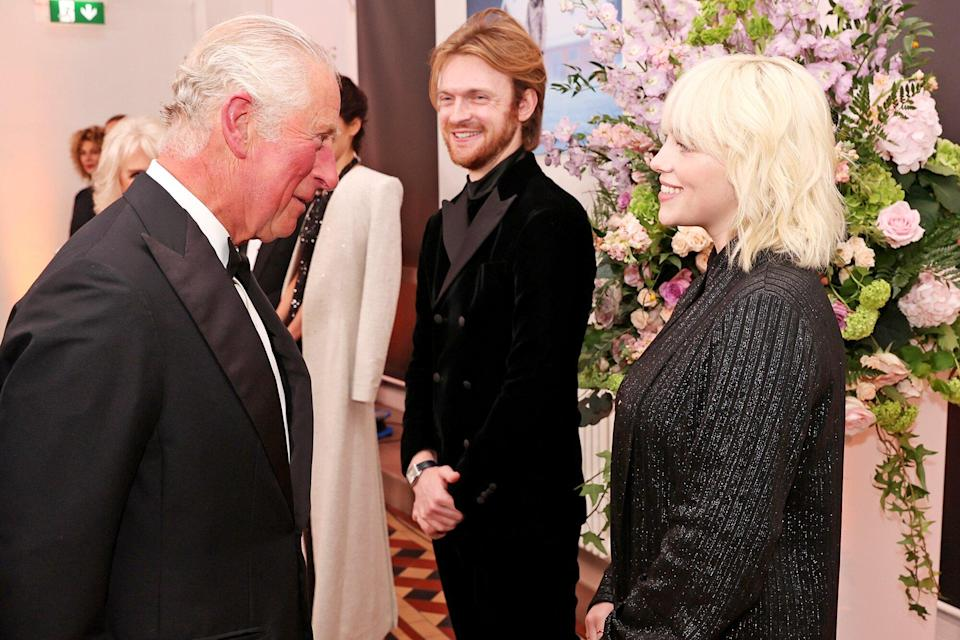 """Prince Charles, Prince of Wales, meets """"No Time To Die"""" Performers Finneas and Billie Eilish at the """"No Time To Die"""" World Premiere at Royal Albert Hall on September 28, 2021 in London"""