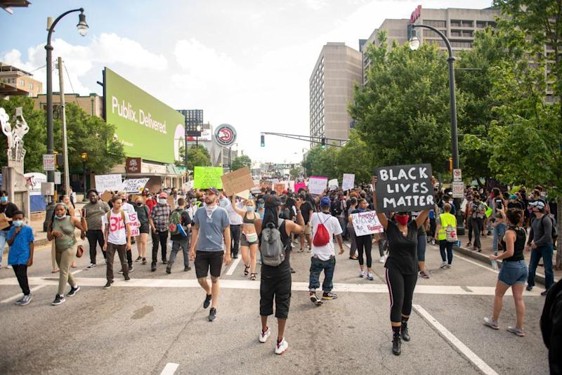 Peaceful protesters take the streets of Atlanta on 4 June.