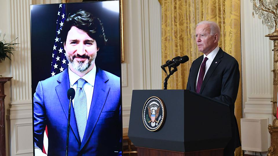 US President Joe Biden and Canadian Prime Minister Justin Trudeau (on screen) speak to the media after holding a virtual bilateral meeting in the East Room of the White House in Washington, DC, February 23, 2021. - President Joe Biden declared Canada and the United States best friends Tuesday, while Prime Minister Justin Trudeau called the friendship