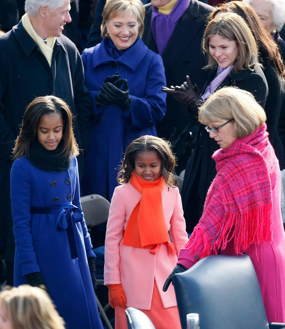 Malia and Sasha Obama pass former President Bill Clinton, then-Sen. Hillary Clinton, and Jenna Bush as they are shown to their seats at the U.S. Capitol ahead of the inauguration of Barack Obama on Jan. 20, 2009. (Photo: Rick Wilking / Reuters)