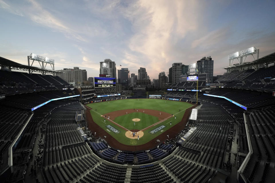 """FILE - In this Oct. 6, 2020, file photo, the Tampa Bay Rays and the New York Yankees play in Game 2 of a baseball AL Division Series in an empty Petco Park in San Diego. Major League Baseball and all 30 of its teams are suing their insurance providers, citing billions of dollars in losses during the 2020 season played almost entirely without fans due to the coronavirus pandemic. The suit, filed in October in California Superior Court in Alameda County, was obtained Friday, Dec. 4, by The Associated Press. It says providers AIG, Factory Mutual and Interstate Fire and Casualty Company have refused to pay claims made by MLB despite the league's """"all-risk"""" policy purchases. (AP Photo/Jae C. Hong, File)"""