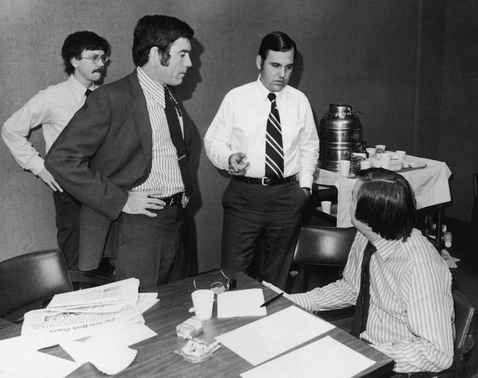 """<div class=""""inline-image__caption""""><p>Presidential assistant and Press Secretary, Ron Zeigler (C), speaks with Dan Rather (L) and other reporters in the press room of the Naval Hospital, where U.S. President Richard Nixon was admitted for pneumonia, July 13, 1973, in Washington, D.C. </p></div> <div class=""""inline-image__credit"""">Getty </div>"""