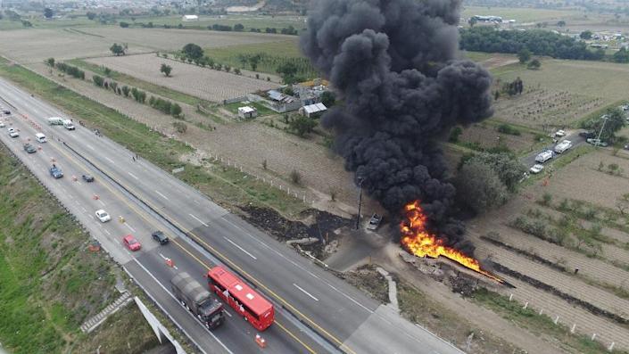 This aerial view taken from a drone shows the flames generated by a fire in a clandestine fuel valve in Mexico's Puebla state in May 2017 - the theft of fuel is part of the wave of violent crime in Mexico's never-ending drug war (AFP Photo/Jose CASTANARES)