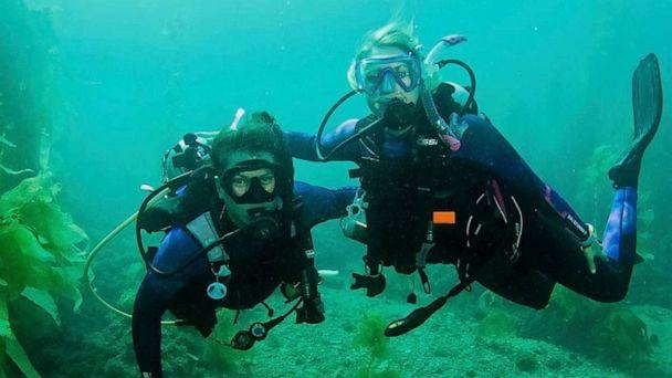 PHOTO: Two Dive Warriors pose for a photo in an underwater kelp forest. (Gene Shabinaw)