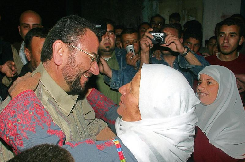 A Palestinian woman hugs Saleh Aruri (L) in the West Bank town of Ramallah, March 11, 2007