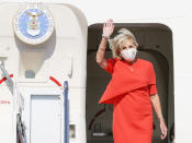 U.S. first lady Jill Biden waves upon arrival at Yokota U.S. Air Force Base, outskirts of Tokyo, Thursday, July 22, 2021. Biden represented the U.S. government at the Tokyo Olympics, to attend the opening ceremony of the Games on Friday, July 23. (Kyodo News via AP)