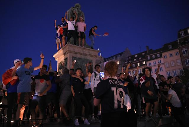 <p>French football supporters celebrate in Strasbourg on July 10, 2018, after France beat Belgium in the first semi-final football match of the 2018 Russia World Cup in Saint Petersburg. (Photo by PATRICK HERTZOG / AFP) </p>