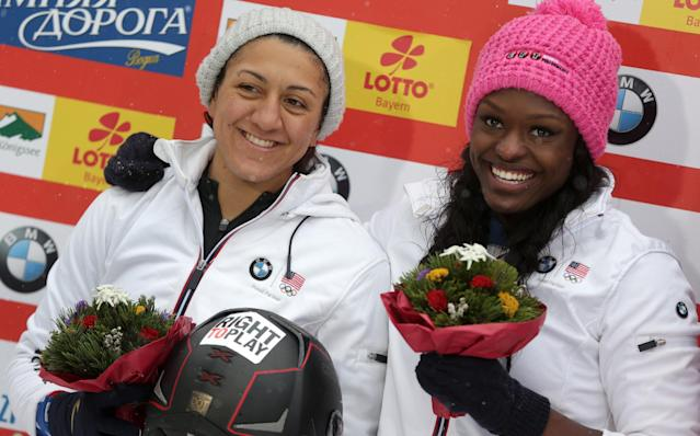 Elana Meyers, left, and Aja Evans of the United States celebrate their second place at the two-woman Bobsled World Cup race in Koenigssee, southern Germany, on Sunday, Jan. 26, 2014. (AP Photo/Matthias Schrader)