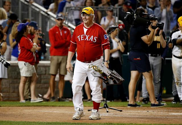 <p>Rep. Joe Barton (R-TX) carries the trophy after the victorious Democrats presented it to the Republicans following the annual Congressional Baseball Game at Nationals Park in Washington, June 15, 2017. (Photo: Joshua Roberts/Reuters) </p>