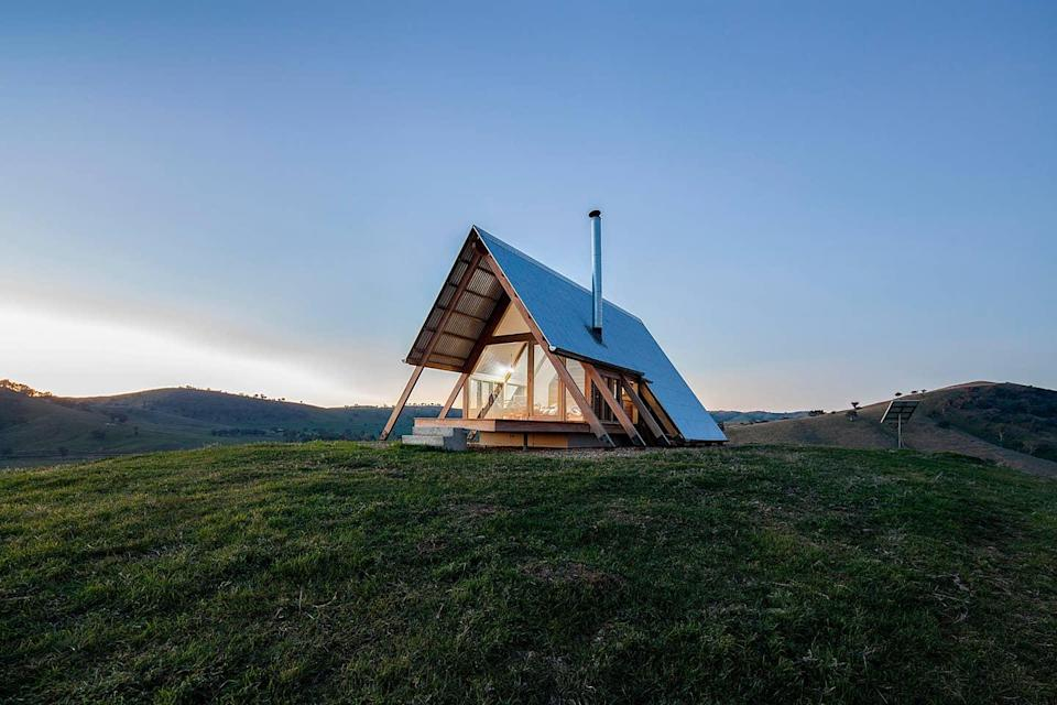 "<p>If you're chasing summer and would rather get far, far away from the dropping temps on your vacay, head south of the Equator and check out this modern A-frame set on a 7,000-acre farm close to Australia's capital city <a href=""https://www.cntraveler.com/story/beyond-the-basics-australia?mbid=synd_yahoo_rss"" rel=""nofollow noopener"" target=""_blank"" data-ylk=""slk:Canberra"" class=""link rapid-noclick-resp"">Canberra</a>. It's completely off-grid (that means no Wi-Fi) thanks to solar panels, and it offers nearly 360-degree views of the surrounding farmland from its combined living room and bedroom—and the bathroom. Yes, even the bathroom has floor-to-ceiling windows, but there isn't a soul for a few thousand acres, so you won't have to worry about privacy. Note that breakfast is provided and there's a kitchenette if you want to cook meals for yourself.</p> <p><strong>Book now:</strong> <a href=""https://airbnb.pvxt.net/JybPa"" rel=""nofollow noopener"" target=""_blank"" data-ylk=""slk:From $252 per night, airbnb.com"" class=""link rapid-noclick-resp"">From $252 per night, airbnb.com</a></p>"