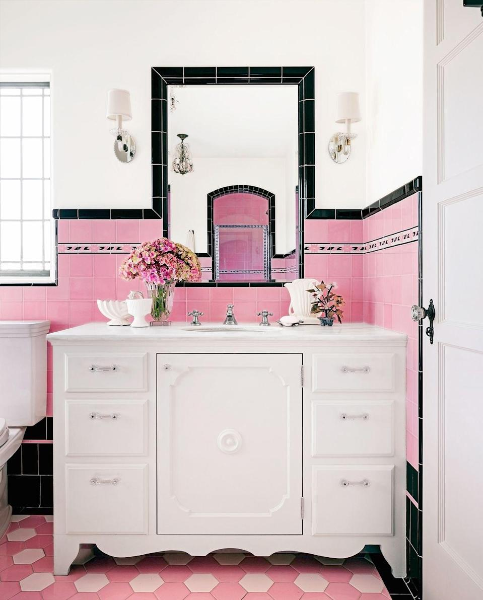 <p>Daring pink tones, including hexagon patterned floor tiles, add to this bathroom's retro vibe. </p>