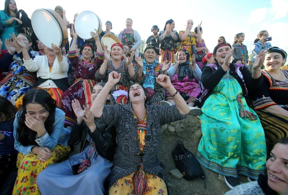 Women spectators cheer during a match in an annual local soccer tournament played by an all women teams, at the village of Sahel, in the mostly Berber Kabylie region in the mountains east of Algiers, Algeria October 16, 2020.