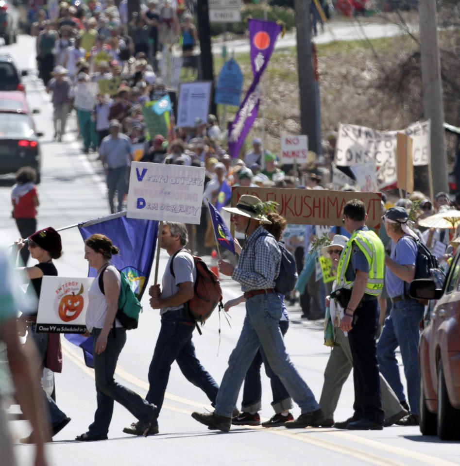 Hundreds of anti-nuclear activists march to the local corporate offices of Vermont Yankee owner Entergy Corp., Thursday, March 22, 2012 in Brattleboro, Vt. (AP Photo/Jim Cole)