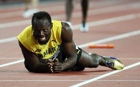 Jamaica's Usain Bolt falls to the track after sustaining an injury during the men's 4x100m Relay final at the London 2017 IAAF World Championships in London, Britain, 12 August 2017 - Credit: EPA