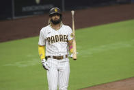 San Diego Padres' Fernando Tatis Jr. flips his bat after striking out against Los Angeles Dodgers starting pitcher Clayton Kershaw in the third inning of a baseball game Monday, Sept. 14, 2020, in San Diego. (AP Photo/Derrick Tuskan)