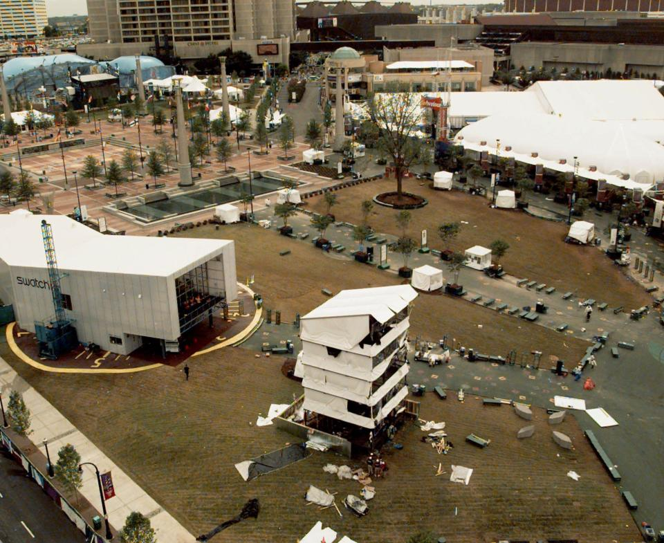 FILE - This Sunday, July 28, 1996, file photo shows Centennial Park at the 1996 Olympic Games in Atlanta, the day after an explosion centered at the bottom of the temporary tower, in the foreground. (AP Photo/John Gaps III, File)