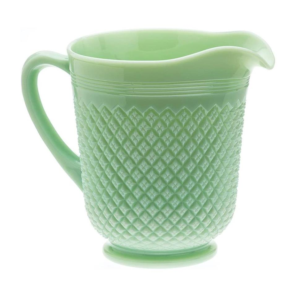 """<p>This pitcher makes a spell spent on the porch feel like you're taking a step back in time to a classic Southern (iced) tea party—just have those tea cakes ready.</p> <p><strong>Buy It: $49; <a href=""""https://www.amazon.com/Jadeite-Pitcher-Vintage-Inspired-Perfect/dp/B075TF2941/ref=as_li_ss_tl?ie=UTF8&linkCode=ll1&tag=slhomejadeitekitchentrendkyarborough0820-20&linkId=33ca1ada1654159a37ddead51dcbfba2&language=en_US"""" rel=""""nofollow noopener"""" target=""""_blank"""" data-ylk=""""slk:amazon.com"""" class=""""link rapid-noclick-resp"""">amazon.com</a></strong></p>"""
