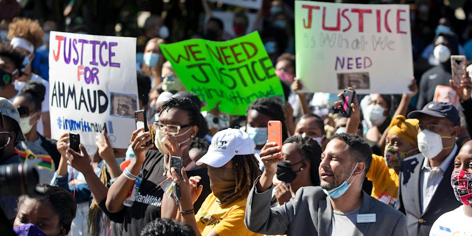 People react during a rally to protest the shooting of Ahmaud Arbery, Friday, May 8, 2020, in Brunswick Ga.