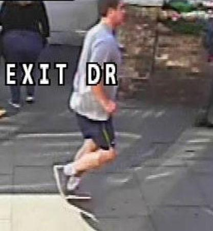 A man jogging whom police wish to speak to after a a woman was pushed into the path of a bus on Putney Bridge is seen in a still image taken from CCTV and handed out by the Metropolitan Police in London
