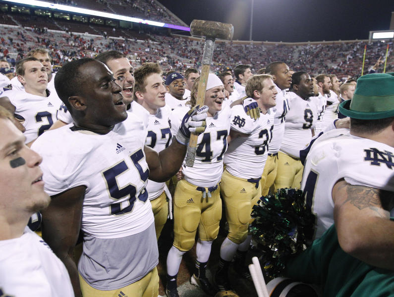 Notre Dame linebacker Prince Shembo wields a sledgehammer as he celebrates with fans following a 30-13 victory over Oklahoma in an NCAA college football game in Norman, Okla., Saturday, Oct. 27, 2012. (AP Photo/Sue Ogrocki)