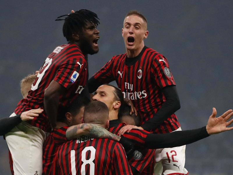 Ibrahimovic is mobbed after scoring in the Milan derby: AP