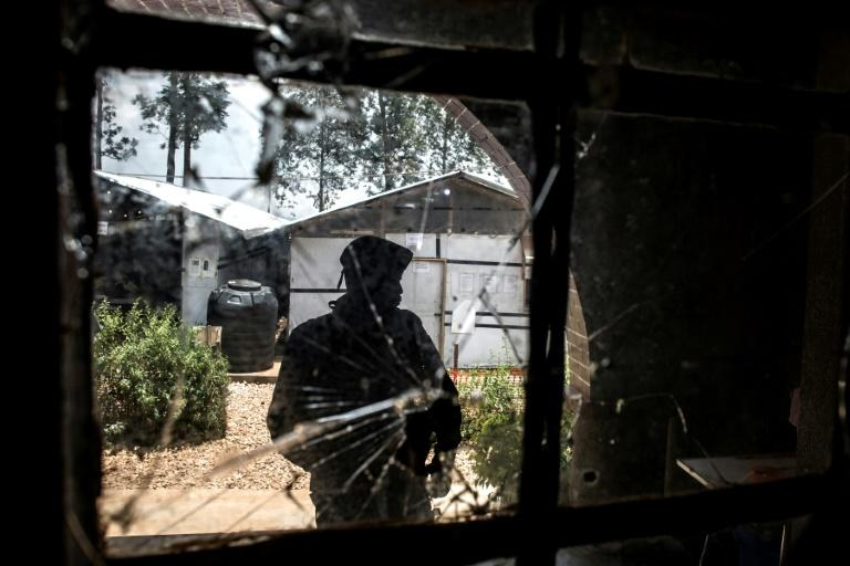 Attacked: The bullet-riddled window of an Ebola treatment centre in Butembo, which was assaulted by suspected Mai-Mai militiamen in March. A policeman was killed and a healthworker wounded