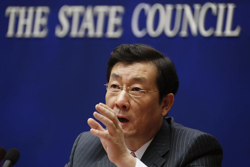 China Securities Regulatory Commission Deputy Chairman Li Chao speaks during a press briefing on the reform, stability and development of the Chinese capital market, at the State Council Information Office in Beijing, Sunday, Feb. 26, 2017. China needs to do more to stop risky behavior in its stock market, a regulator said Sunday, following a 2015 collapse in share prices and complaints investors are engaged in a dangerous new round of speculative buying. (AP Photo/Andy Wong)