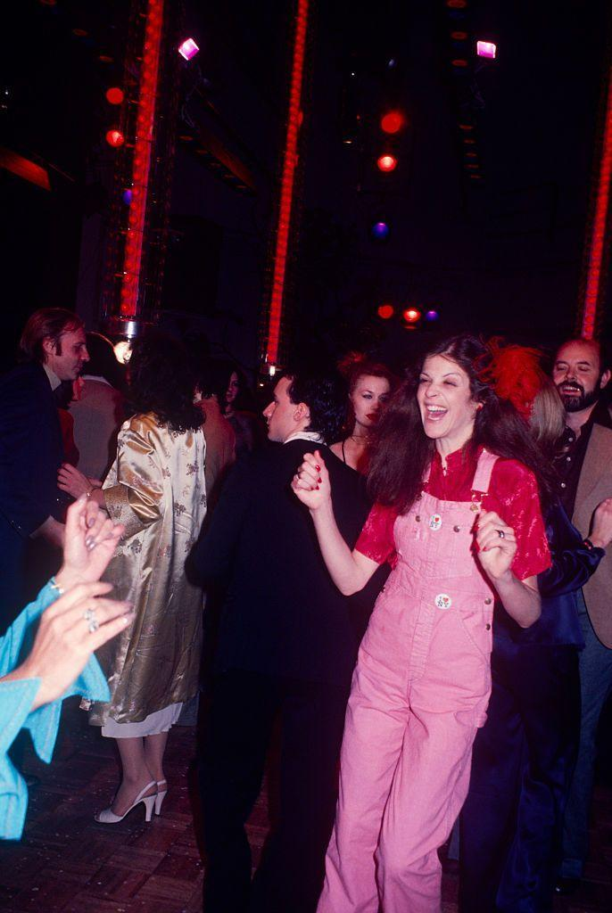 <p>Comedian Gilda Radner wears pink overalls for a night of dancing at Studio 54 in 1970. </p>