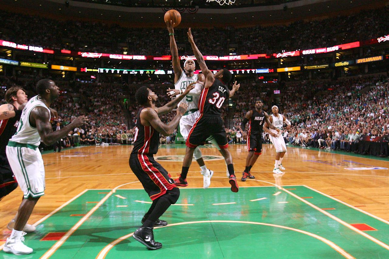 BOSTON, MA - JUNE 03:  Rajon Rondo #9 of the Boston Celtics attempts a shot in the first quarter against Norris Cole #30 of the Miami Heat in Game Four of the Eastern Conference Finals in the 2012 NBA Playoffs on June 3, 2012 at TD Garden in Boston, Massachusetts. NOTE TO USER: User expressly acknowledges and agrees that, by downloading and or using this photograph, User is consenting to the terms and conditions of the Getty Images License Agreement.  (Photo by Jim Rogash/Getty Images)