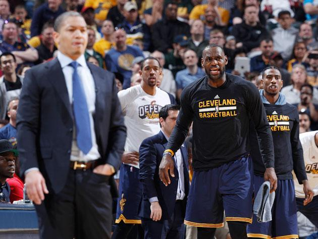 LeBron James looks on as another blowout spins away. (Getty Images)