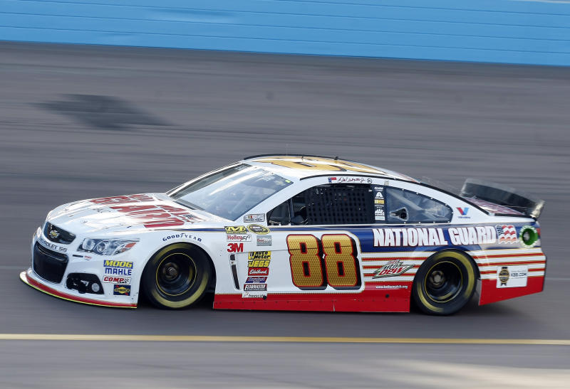 Dale Earnhardt Jr. (88) drives during qualifying for Sunday's NASCAR Sprint Cup Series auto race, Friday, Feb. 28, 2014, in Avondale, Ariz. (AP Photo/Rick Scuteri)