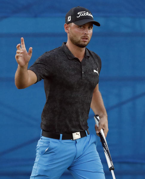 Adam Svensson waves after making birdie on the 18th green to take the lead during the first round of the Sony Open golf tournament Thursday, Jan. 10, 2019, at Waialae Country Club in Honolulu. (AP Photo/Matt York)